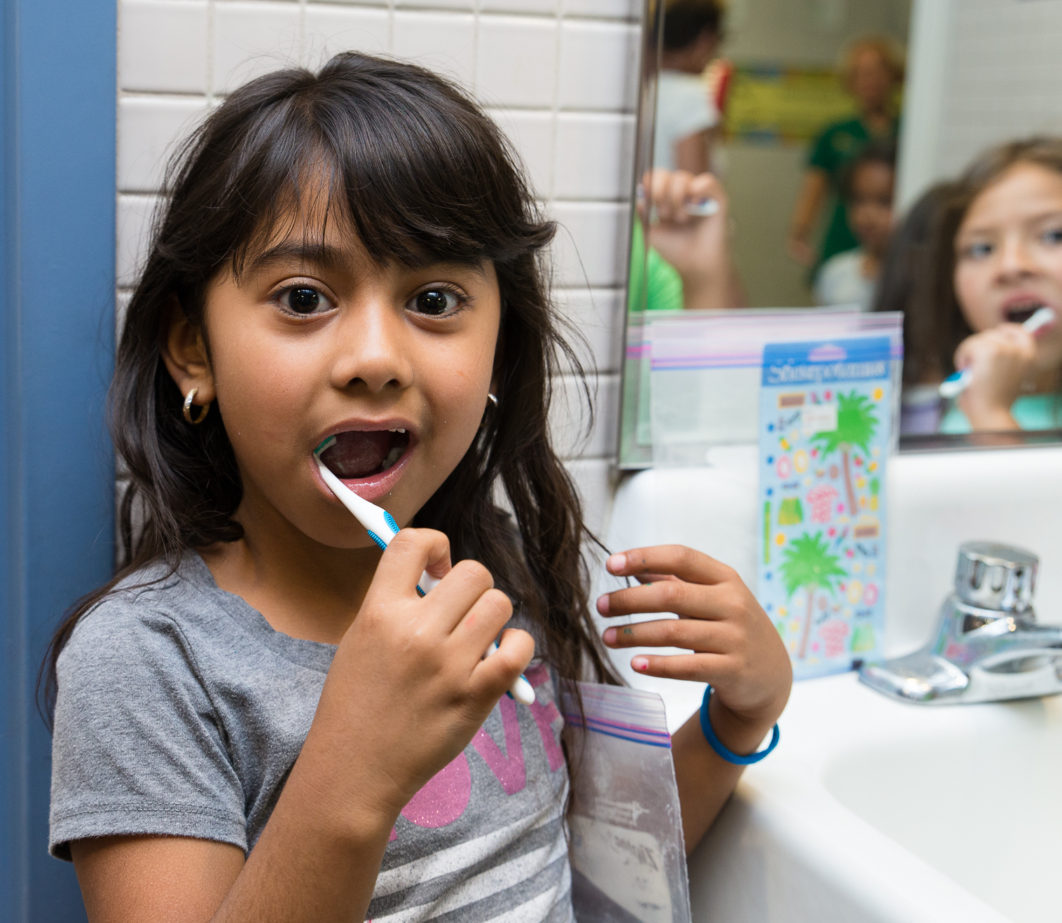 Future Smiles girl brushes her teeth.