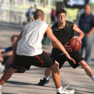 Students playing basketball for exercise