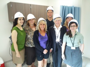 Staff in hard hats visiting an SBHC