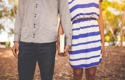 Teen couple holding hands